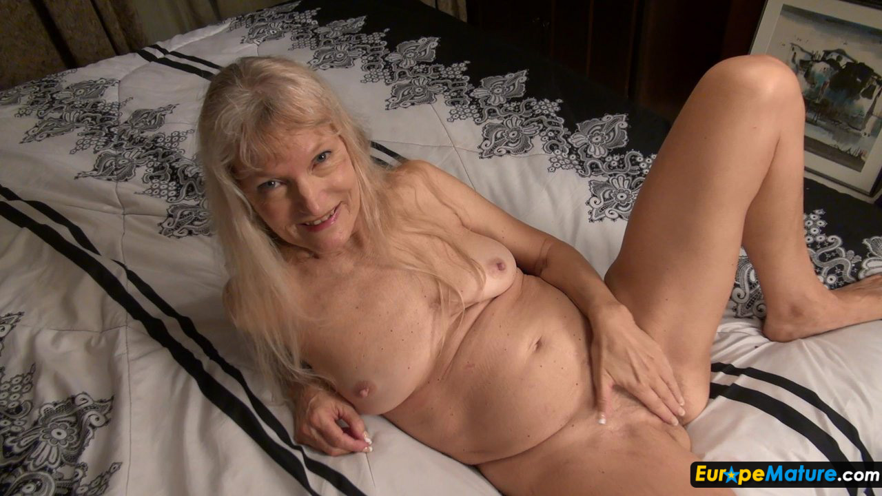 Skinny blonde with a big dildo 9